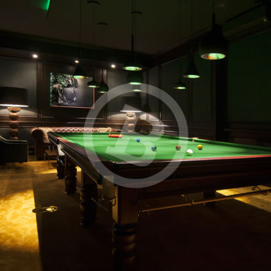 Elegant snooker room with dim lights, picture taken in Marbella