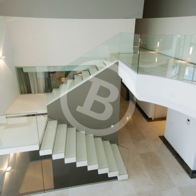 Perspectives, lines and curves in this interior real estate picture. Photo taken in Marbella, Málaga