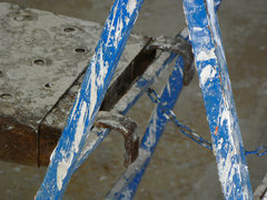 Blue ladder covered with paint